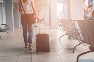 Woman passes through the airport terminal with her luggage